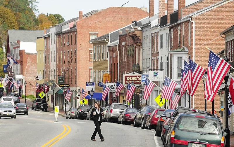 Staff photo by Joe Phelan A pedestrian cross Water Street recently in downtown Hallowell.