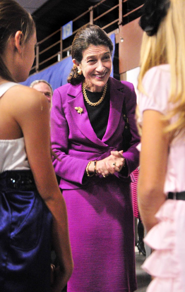 U.S. Sen. Olympia Snowe, center, greets Mia-Angelina Leslie, left, 10, and her sister Maddy Leslie, 12, both of Lewiston, on Friday evening at the start of the Maine State Chamber of Commerce Awards at the Augusta Civic Center.