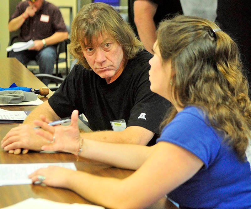 David Lehoux, left, talks to Beverly Robbins, of Preble Street Resource Center about transitional housing during the annual Maine Homeless Veterans Stand Down on Saturday at the VA Healthcare Systems Maine Medical Center - Togus.