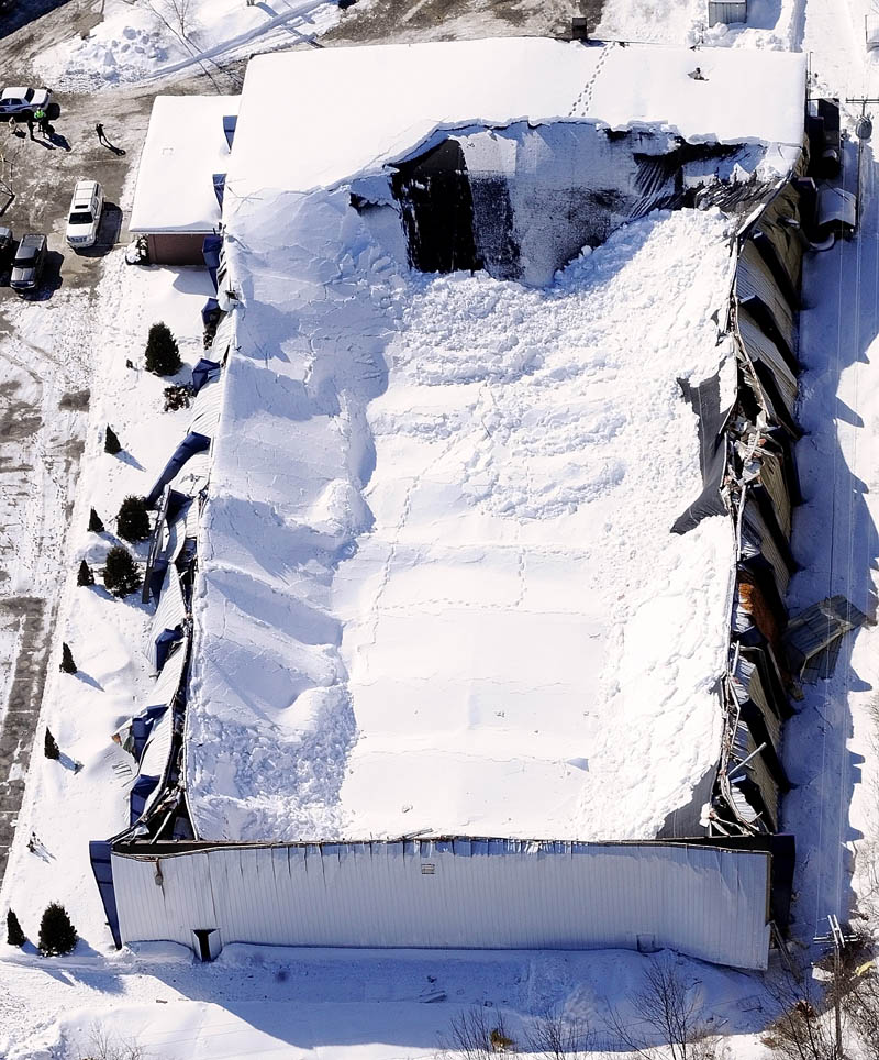 This aerial photo taken Thursday shows the collapsed roof of the Kennebec Ice Arena in Hallowell. No one was injured when the roof fell onto the rink on Wednesday afternoon.