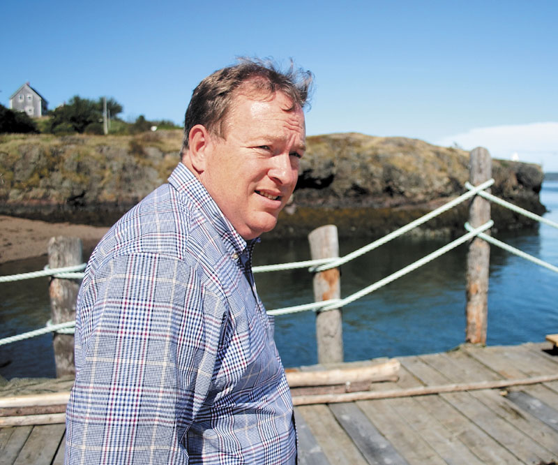 State Senate President Kevin Raye strolls a pier overlooking Cummings Cove on Passamaquoddy Bay during a recent tour of his native Eastport. The pier is home to Eastport Chowderhouse, where Raye worked as a server during his teen years. Raye, a Republican, is running against Democratic incumbent Mike Michaud for the U.S. House of Representatives in Maine's 2nd Congressional District.