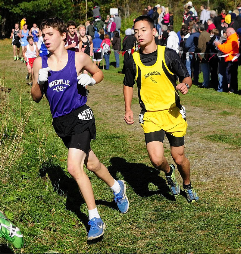 Waterville's Billy Chambers, left, and Maranacook's Koji Kobayashi round a curve during KVAC cross country meet on Saturday morning at Cony High School in Augusta.