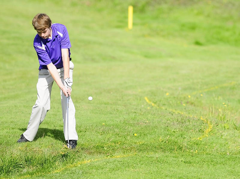 Waterville's Keaton Lahneman chips onto 18th green of Tomahawk course during the Kennebec Valley Athletic Conference qualifier tournament on Tuesday at Natanis Golf Club in Vassalboro.