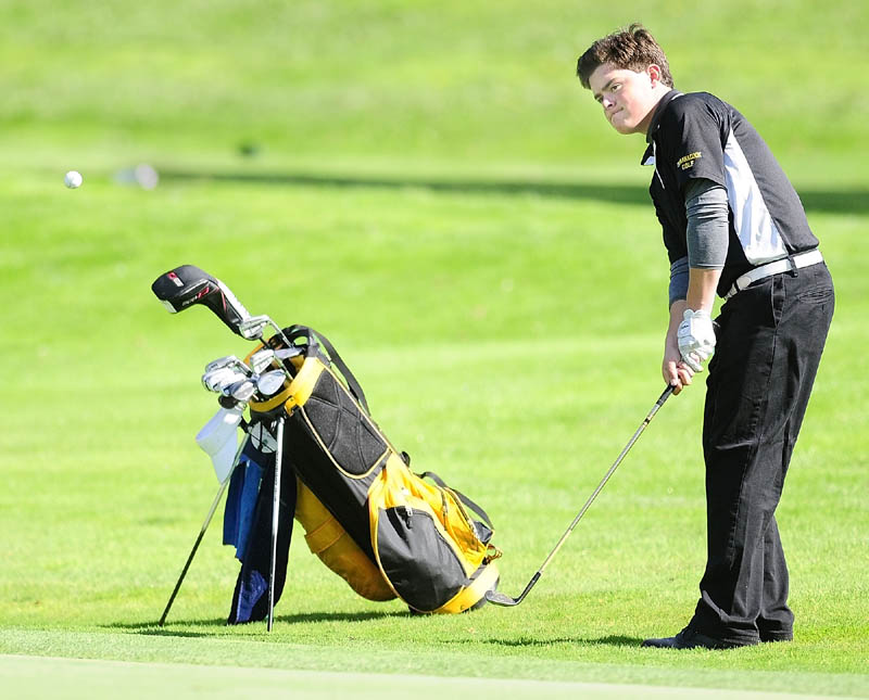 SOLID PLAY: Maranacook's Tucker Whitman chips onto 18th green of the Tomahawk course during the Kennebec Valley Athletic Conference qualifier tournament on Tuesday at Natanis Golf Club in Vassalboro. Maranacook qualified for the team tournament with a 321, while Whitman qualfied for the individual tournament with an 82.