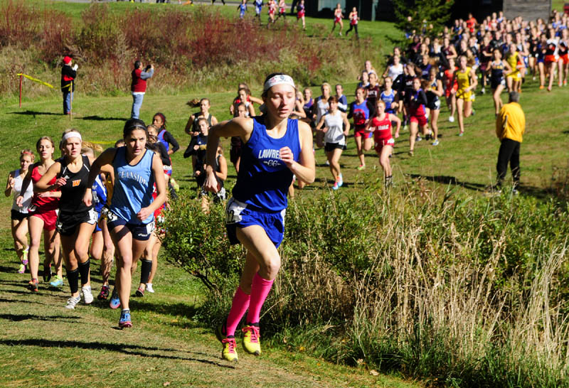 Staff photo by Joe Phelan Lawrence's Erzsebet Nagy runs in fourth place early in the race during KVAC cross country meet on Saturday morning at Cony High School in Augusta.