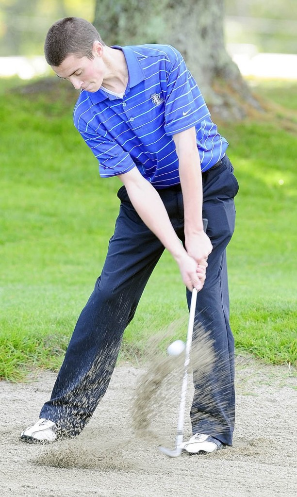 Lawrence's Zachary Hale hits out of a bunker on 18th hole of Arrowhead during the Kennebec Valley Athletic Conference qualifier tournament on Tuesday at Natanis Golf Club in Vassalboro.
