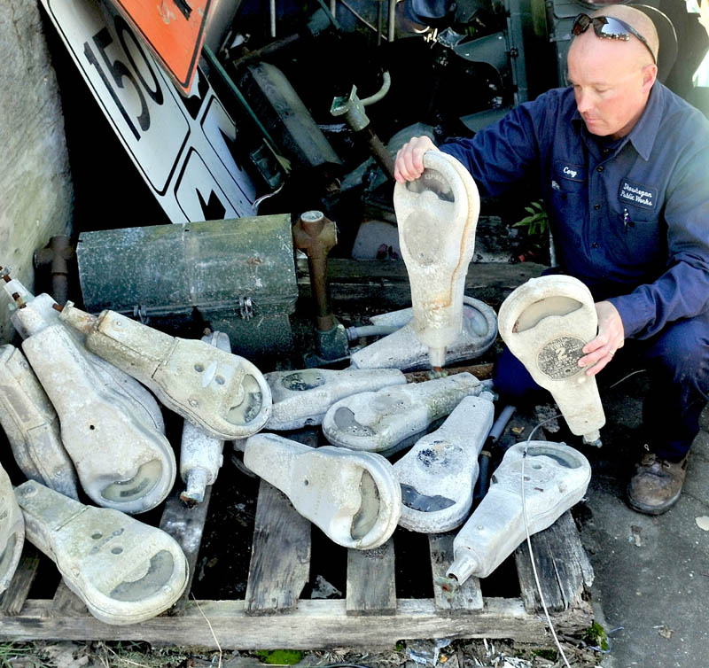 Corey Johnson looks over some of Skowhegan's long-unused parking meters, which the town is now selling.
