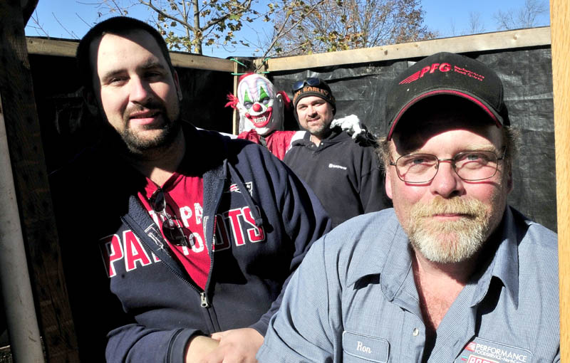 """SPOOKS: These men and many others have created the """"Nightmare on North Main Street"""" haunted trail in Pittsfield to scare the expected 800 visitors this Halloween. From left are Matt Dunton, a demonic clown, and Patrick and Ron Steeves."""