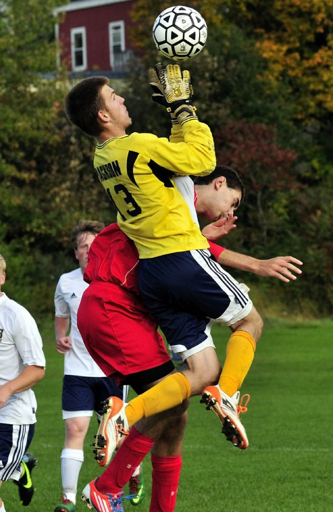 BIG AIR: Mt. Blue's keeper Zach Jackson (13) makes a save as Cony's Matt Canwell pressures during game Monday in Farmington.