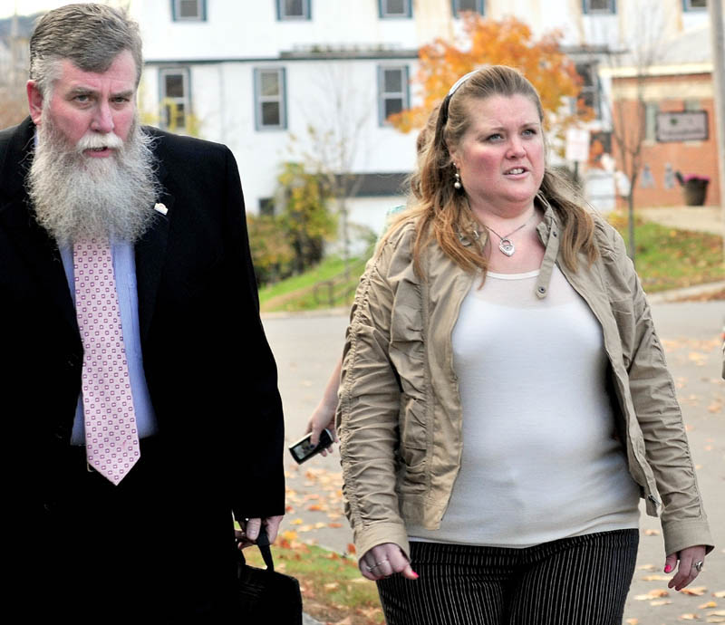 Amanda Huard and attorney John Youney enter Skowhegan District Court on Monday for a hearing for her daughter Kelli Murphy, 11, who has been charged with manslaughter in the death of Brooklyn Foss-Greenaway.