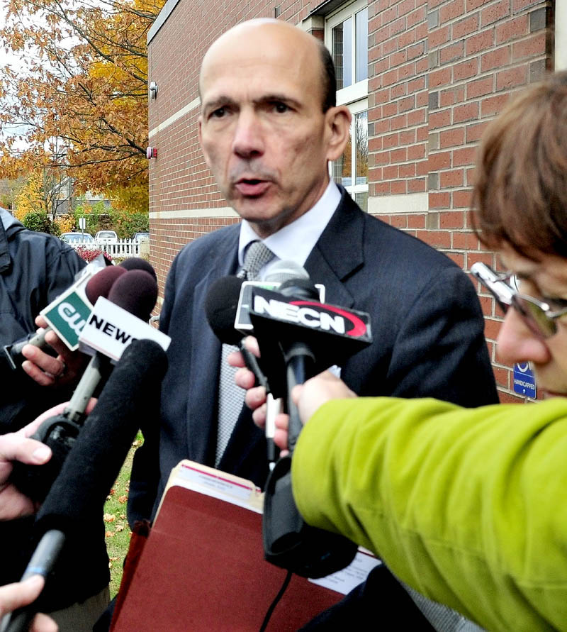 Assistant Attorney General Andrew Benson speaks to reporters following a hearing for defendant Kelli Murphy, 11, in Skowhegan District Court on Monday.