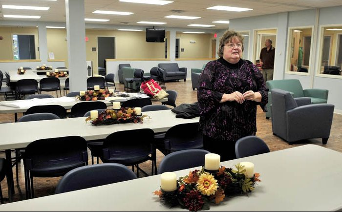 Mid-Maine Homeless Shelter Executive Director Betty Palmer gave a tour of the new shelter in Waterville in 2014. Palmer is speaking in the shelter's multipurpose room.