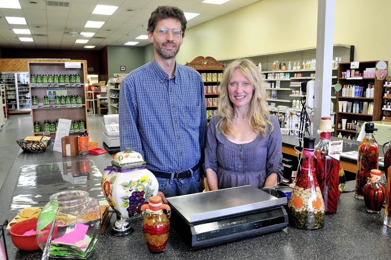 Bryce Boynton and JeanMarie Smith inside their Spice of Life natural foods store in Skowhegan.