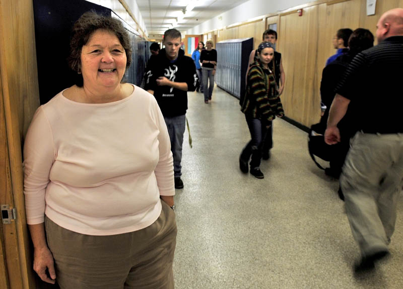 Julie Richard stands back as students move between classes at Upper Kennebec Valley Memorial High School in Bingham. Richard is the new principal at the school and both Quimby Middle and Moscow Elemenatary schools.