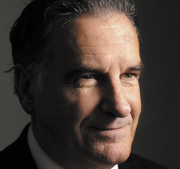 Mike Cote, 57, a drywall finisher from Ogunquit, photographed in his home Monday, October 21, 2012, is the nation's leading Mitt Romney impersonator.