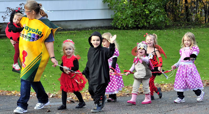 HAPPY HALLOWEEN: Children with the Happy Hearts daycare led by Judy DeFelice, go on an early Halloween parade along Johnson Heights in Waterville this morning.