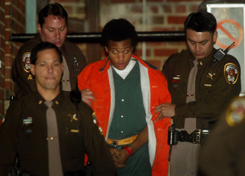Lee Boyd Malvo is escorted from court in Fairfax, Va., in 2003, after a hearing in connection with the D.C. sniper shootings. Now in prison for life, Malvo urges the survivors of his victims to resist being victimized themselves by dwelling on what Malvo and his partner did.