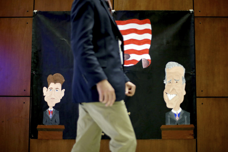 A banner made by middle school students for Thurday's debate at Centre College in Danville, Ky., depicts Republican vice presidential candidate Paul Ryan, left, and Vice President Joe Biden.
