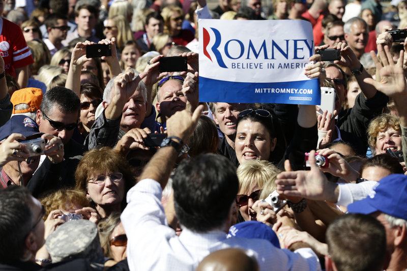 Republican presidential candidate Mitt Romney campaigns at the Mobility Supercenter in Richmond, Va., on Friday. He's seeing bigger crowds since the presidential debate.