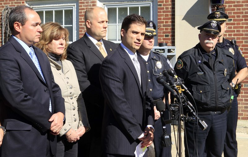 "New Hampshire Assistant Attorney General James Vara, center, holds a news conference Saturday in Dover, N.H., where he announced that a University of New Hampshire student reported missing last week, Elizabeth ""Lizzi"" Marriott, was dead and a 29-year-old Dover man has been charged with second-degree murder in connection with her slaying."