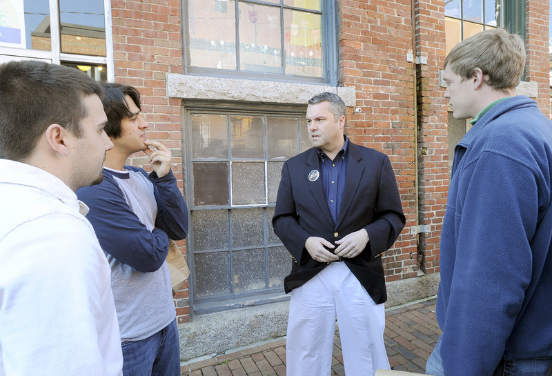 Jon Courtney, Republican candidate for Maine's 1st District House seat, chats with Josh Leger, Tim Bremm and Mike Brown in Portland's Old Port last week.