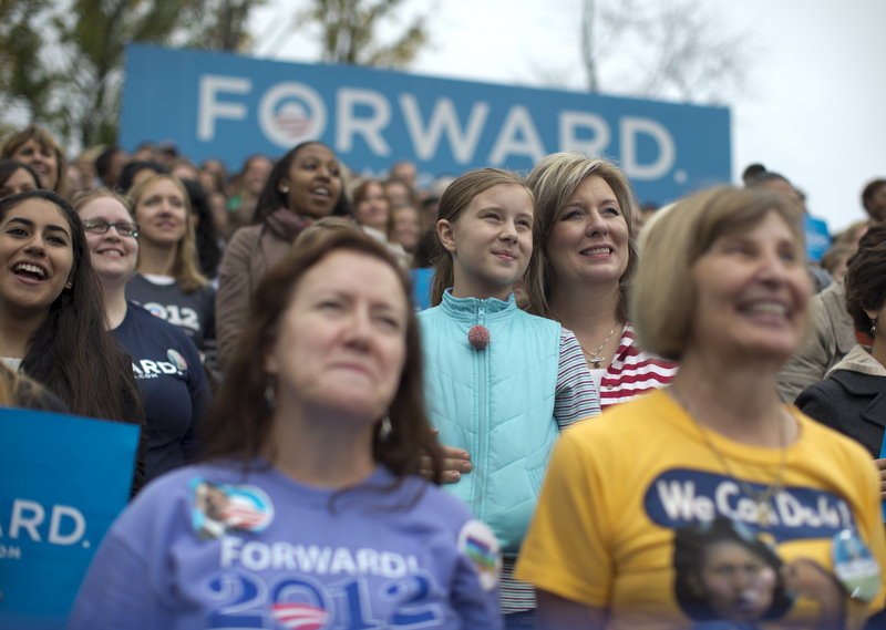 Supporters listen to President Obama speak about the choice facing women in the upcoming election on Friday at George Mason University in Fairfax, Va.