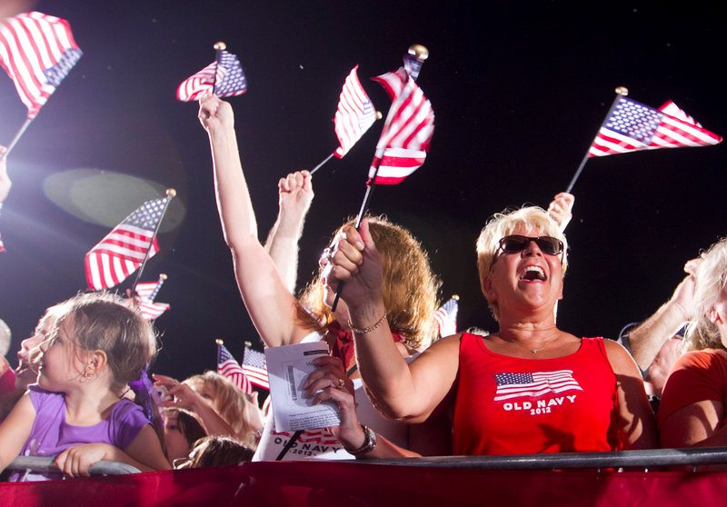 Supporters Judy Groth, center, and Debbie Kohl, right, cheer for Rep. Paul Ryan, R-Wis., the Republican vice-presidential candidate, Thursday in south Fort Myers, Fla.