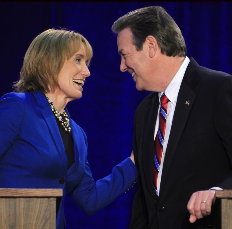 New Hampshire gubernatorial candidates Maggie Hassan, who is a Democrat, and Ovide Lamontagne meet at a debate in Henniker. Unions have launched ads against Lamontagne, a Republican, who has said he would sign a right-to-work bill.