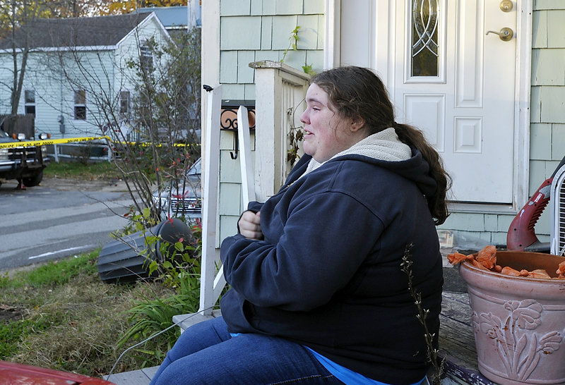 Caleigh Mills, who lives across the street from the Old Orchard Beach fire, weeps after hearing of Patricia Noel's death.