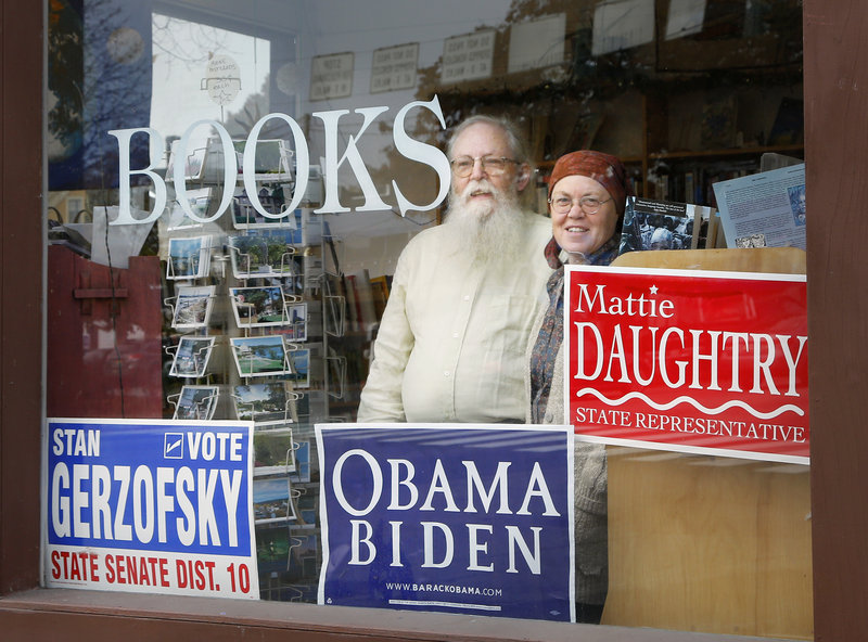 """Gary Lawless and his wife, Beth Leonard, have been criticized for displaying a sign at Gulf of Maine Books in Brunswick backing a Democratic House candidate who Lawless calls """"young, smart and really energetic"""" instead of the Green Independent candidate."""