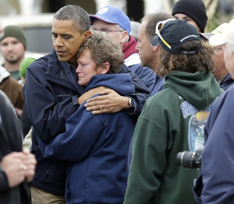 President Obama embraces Donna Vanzant during a Wednesday tour of a Brigantine, N.J., neighborhood affected by superstorm Sandy.