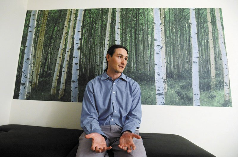 Dr. Dustin Sulak speaks with a reporter at his Falmouth practice. Sulak, who also has a practice in Hallowell, is one of the most sought after Maine doctors to write prescriptions for medical marijuana.
