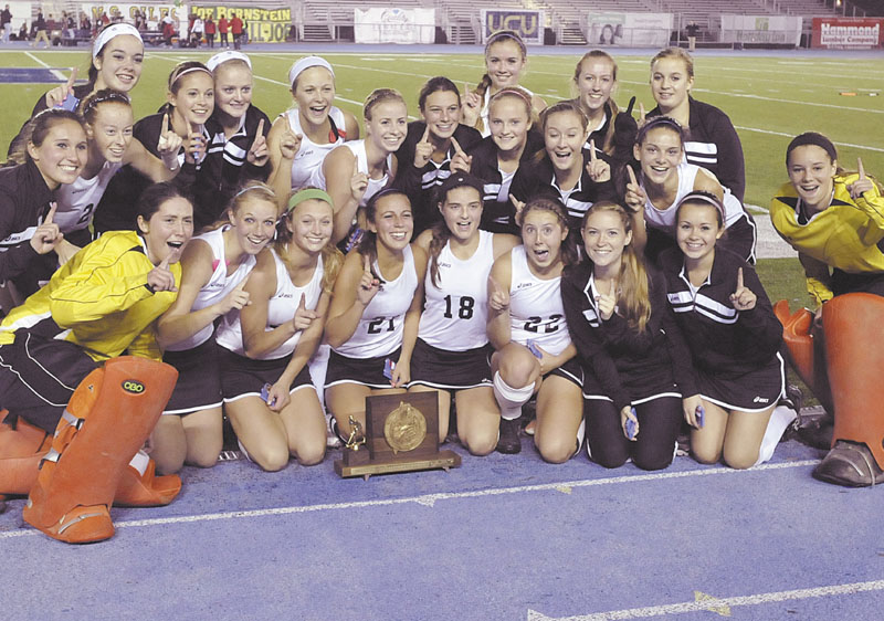 STATE CHAMP: The Skowhegan Area High School field hockey team poses for pictures after winning the Class A state championship with a 3-0 win over Scarborough on Saturday in Orono.
