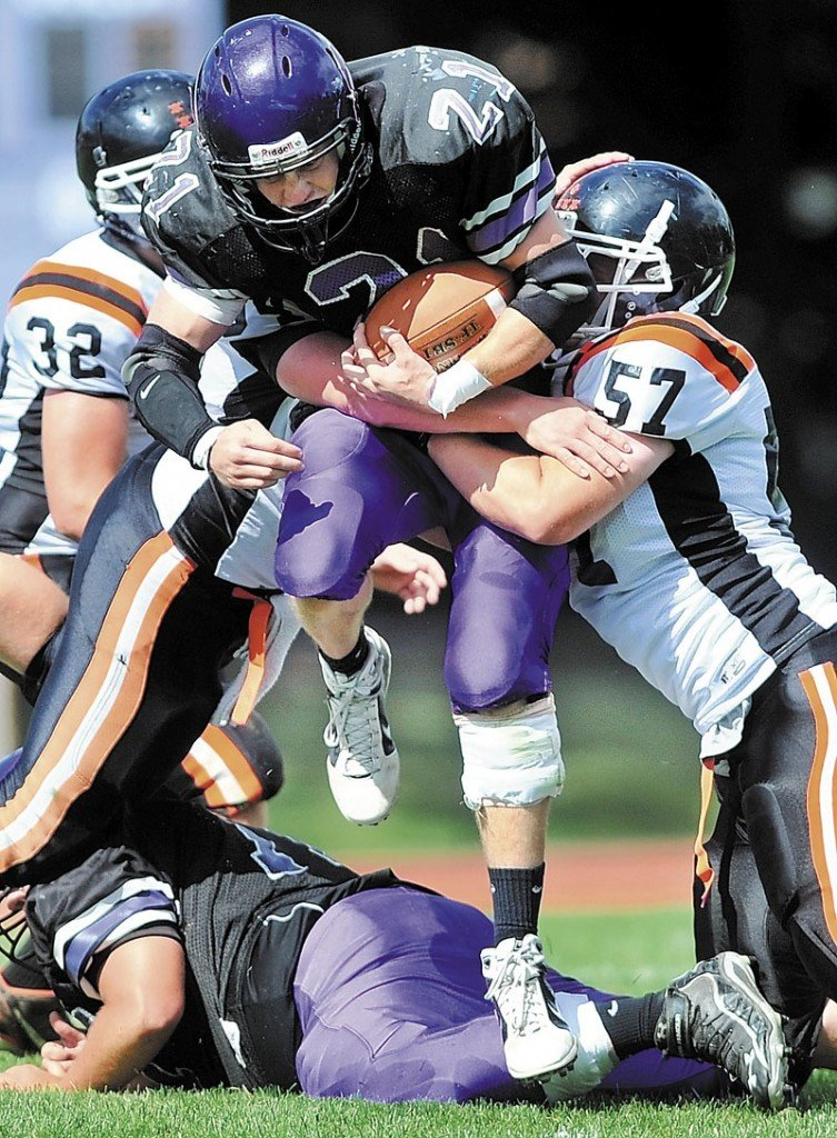 BIG GAME: Racean Wood, center, and the Waterville football team face Hampden Academy in a Pine Tree Conference Class B quarterfinal game tonight.