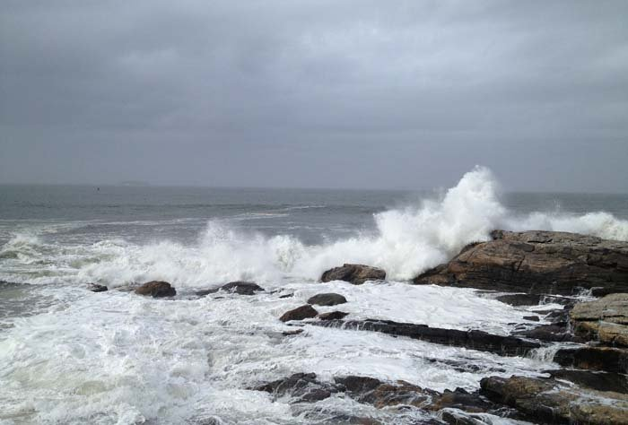 Large waves pound the rocks on Carrying Place Head Island on Tuesday.