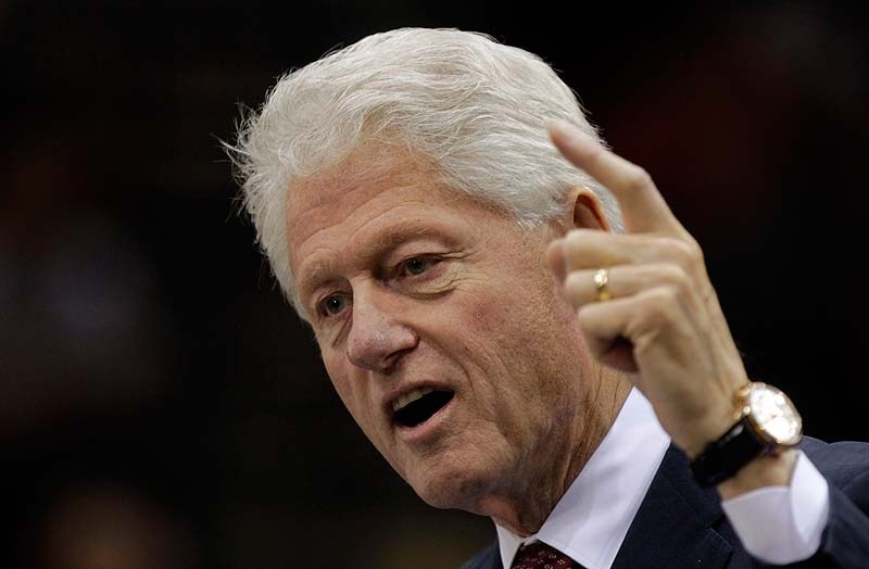 "Former President Bill Clinton speaks at a ""Hoosier Common Sense"" rally for Democratic U.S. Senate candidate Joe Donnelly and Indiana gubernatorial Democratic candidate John Gregg in Indianapolis on Friday."