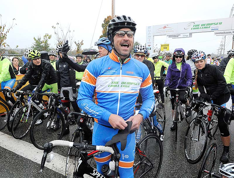 Actor Patrick Dempsey acknowledges riders and spectators as he prepares to set out with first group of riders at the Dempsey Challenge in Lewiston on Sunday.
