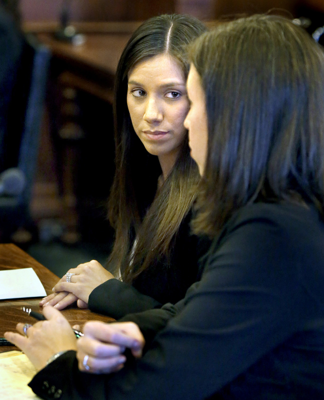 Alexis Wright, left, listens to her lawyer Sarah Churchill during Wright's arraignment on Oct. 10 at the Cumberland County Courthouse in Portland. Wright and her business associate, Mark Strong Sr. of Thomaston, pleaded not guilty to dozens of counts arising from an alleged prostitution operation in Kennebunk.