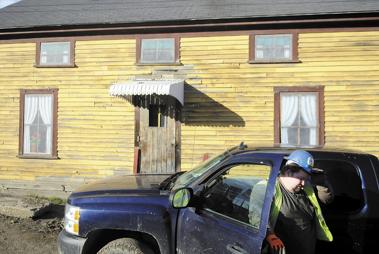 Doug Grant climbs out his pickup truck Tuesday, in front of 25 Bond St. in Augusta. The Augusta City Council has opted to sell the property to a preservation-minded owner. Grant was working on the nearby storm and wastewater treatment project.