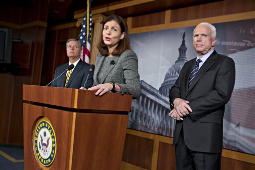 """Sen. John McCain, R-Ariz., right, the ranking member of the Senate Armed Services Committee, right, joined by Sen. Lindsey Graham, R-S.C., far left, and Sen. Kelly Ayotte, R-N.H., center, says he would do all he could to block the nomination of United Nations Amb. Susan Rice to replace Secretary of State Hillary Rodham Clinton because of comments she made after the deadly Sept. 11 attack on the U.S. consulate in Benghazi, at a press conference at the Capitol in Washington, Wednesday, Nov. 14, 2012. President Barack Obama later responded in a news conference saying Rice's critics should """"go after me"""" � not her � if they have issues with the administration's handling of the deadly attacks on Americans in Benghazi, Libya. (AP Photo/J. Scott Applewhite)"""