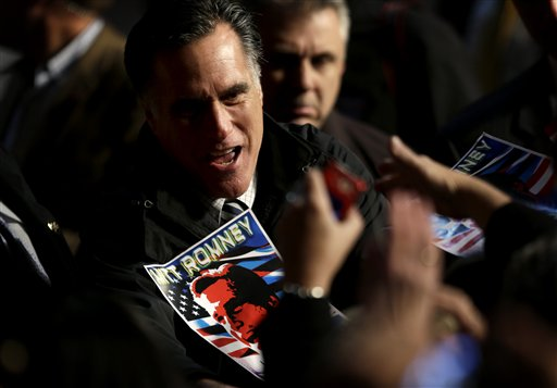 Republican presidential candidate, former Massachusetts Gov. Mitt Romney greets supporters at a campaign event at the Newport News International Airport, Sunday, Nov. 4, 2012, in Newport News, V.A. (AP Photo/David Goldman)