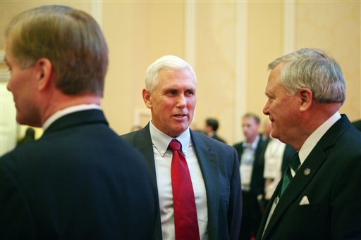 Indiana Governor-Elect Mike Pence, center, speaks with Georgia Gov. Nathan Deal, right, prior to a panel discussion during the 2012 RGA Annual Conference at Encore hotel-casino Thursday, Nov. 15, 2012, in Las Vegas. (AP Photo/Ronda Churchill)