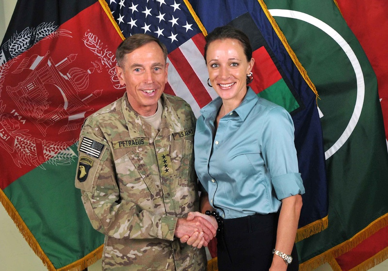 """This July 13, 2011, photo made available on the International Security Assistance Force's Flickr website shows the former Commander of International Security Assistance Force and U.S. Forces-Afghanistan Gen. Davis Petraeus, left, shaking hands with Paula Broadwell, co-author of """"All In: The Education of General David Petraeus."""" The two allegedly had an affair, which led to Gen. Petraeus' resignation as director of the Central Intelligence Agency. (AP Photo/ISAF)"""