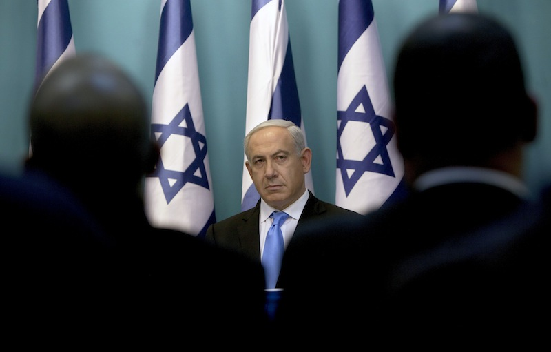 Israeli Prime Minister Benjamin Netanyahu looks on during joint statements together with Israel's Defense Minister Ehud Barak and Israeli Foreign Minister Avigdor Lieberman, not seen, at the Prime Minister's office in Jerusalem, Wednesday, Nov. 21, 2012. Israel and the Hamas militant group agreed to a cease-fire Wednesday to end eight days of the fiercest fighting in nearly four years, promising to halt attacks on each other and ease an Israeli blockade constricting the Gaza Strip. (AP Photo/Sebastian Scheiner)