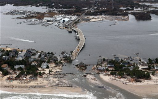 This aerial photo made from a helicopter shows storm damage from Sandy over the Atlantic Coast in Mantoloking, N.J., on Wednesday. The photo was made from a helicopter behind the helicopter carrying President Obama and New Jersey Gov. Chris Christie, as they viewed storm damage from superstorm Sandy.