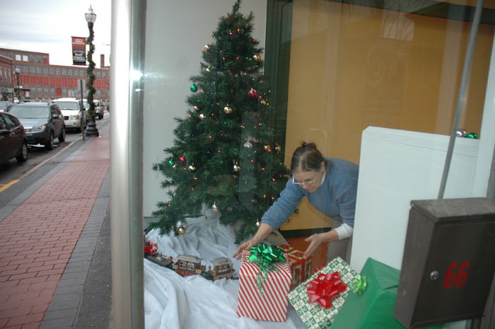 Amy Rouse, a volunteer with Main Street Skowhegan, prepares the the window for Santa's Village downtown, part of Skowhegan's Holiday Stroll festvities, which kick off Friday.