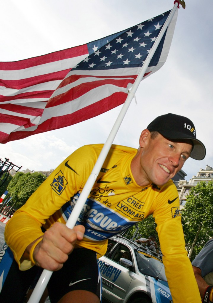 In this 2005 file photo, Lance Armstrong takes part in a victory parade on the Champs Elysees in Paris after winning his seventh straight Tour de France cycling race.