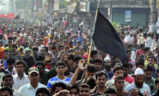 Bangladeshi garment workers march in protest on Tuesday to mourn the victims of Saturday's fire in a garment factory on the outskirts of Dhaka. Bangladesh held a day of mourning for the 112 people killed in the weekend fire, and labor groups planned more protests to demand better worker safety in an industry notorious for operating in firetraps.