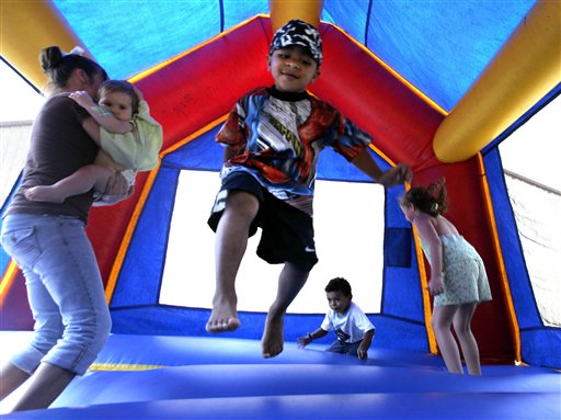 Children play in a bounce house in Vidor, Texas. A nationwide study found inflatable bounce houses can be dangerous and the number of kids injured in related accidents has soared 15-fold in recent years.