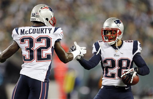 CORRECTS TO SAY CELEBRATION WAS FOR AN INTERCEPTION, NOT A TOUCHDOWN - New England Patriots strong safety Steve Gregory (28) celebrates with teammates after intercepting a pass from New York Jets Mark Sanchez during the first half of an NFL football game, Thursday, Nov. 22, 2012, in East Rutherford, N.J. (AP Photo/Julio Cortez) NFLACTION12;